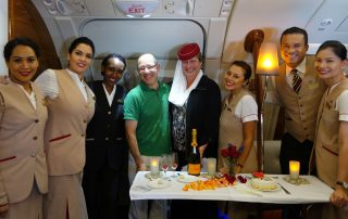 A surprise anniversary party at 40,000 feet! Karen got to wear Emirates' signature uniform hat. Maybe I should have too, to cut the glare.