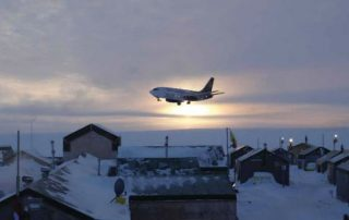 A Nolinor Boeing 737-200C, landing in the twilight at a remote Northern exploration site. Photo: Nolinor