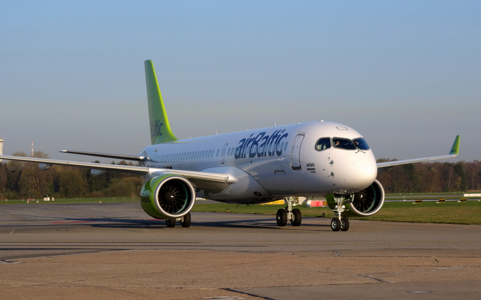 Newly-delivered airBaltic CS300 at Hamburg Airport