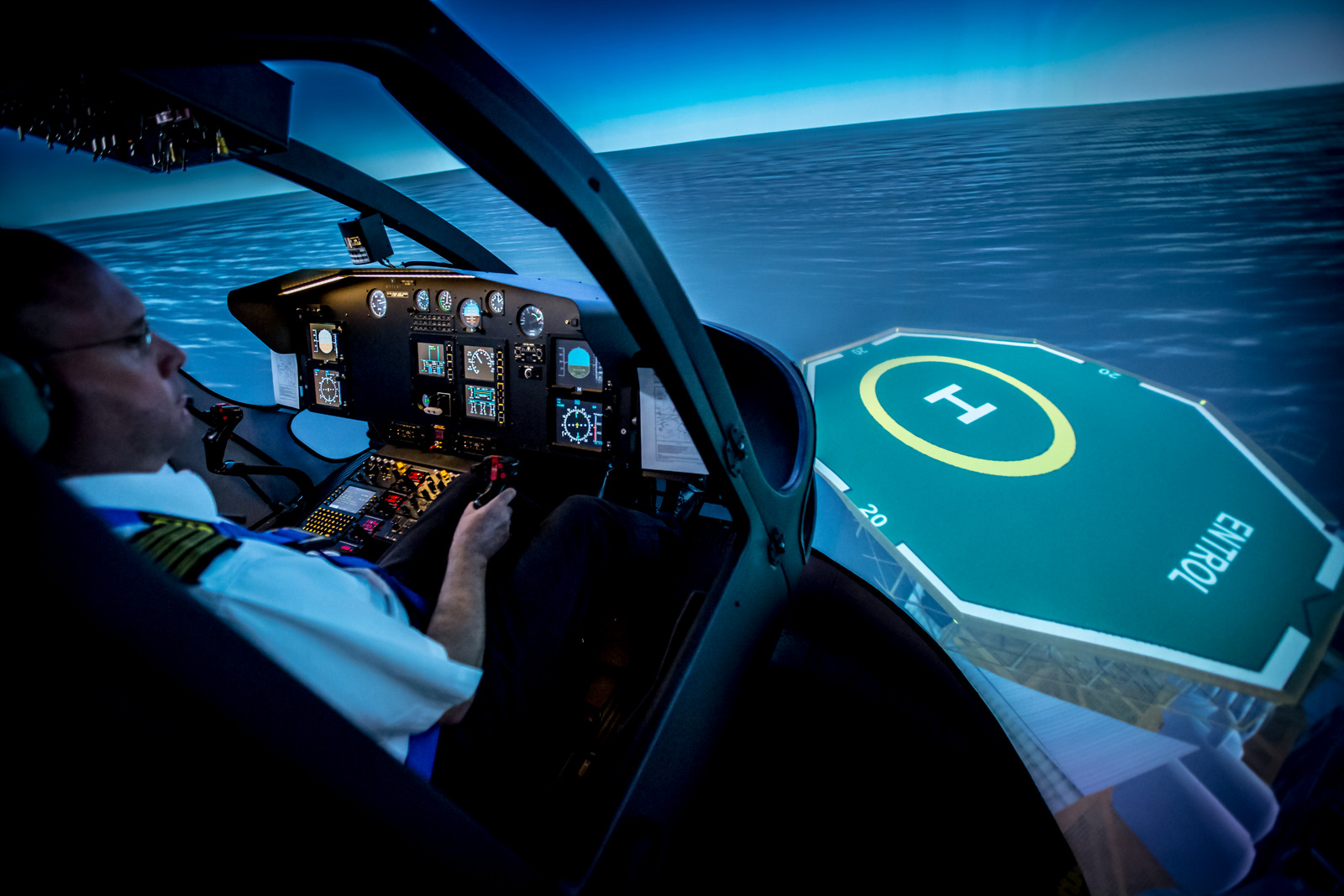 A pilot flying an Entrol helicopter sim approaches an oil platform pad. Photo: Entrol