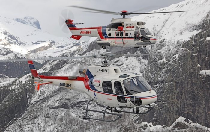 One of Airlift's Airbus AS350 B3 and its sole AS332 C Super Puma. Photo: Anthony Pecchi