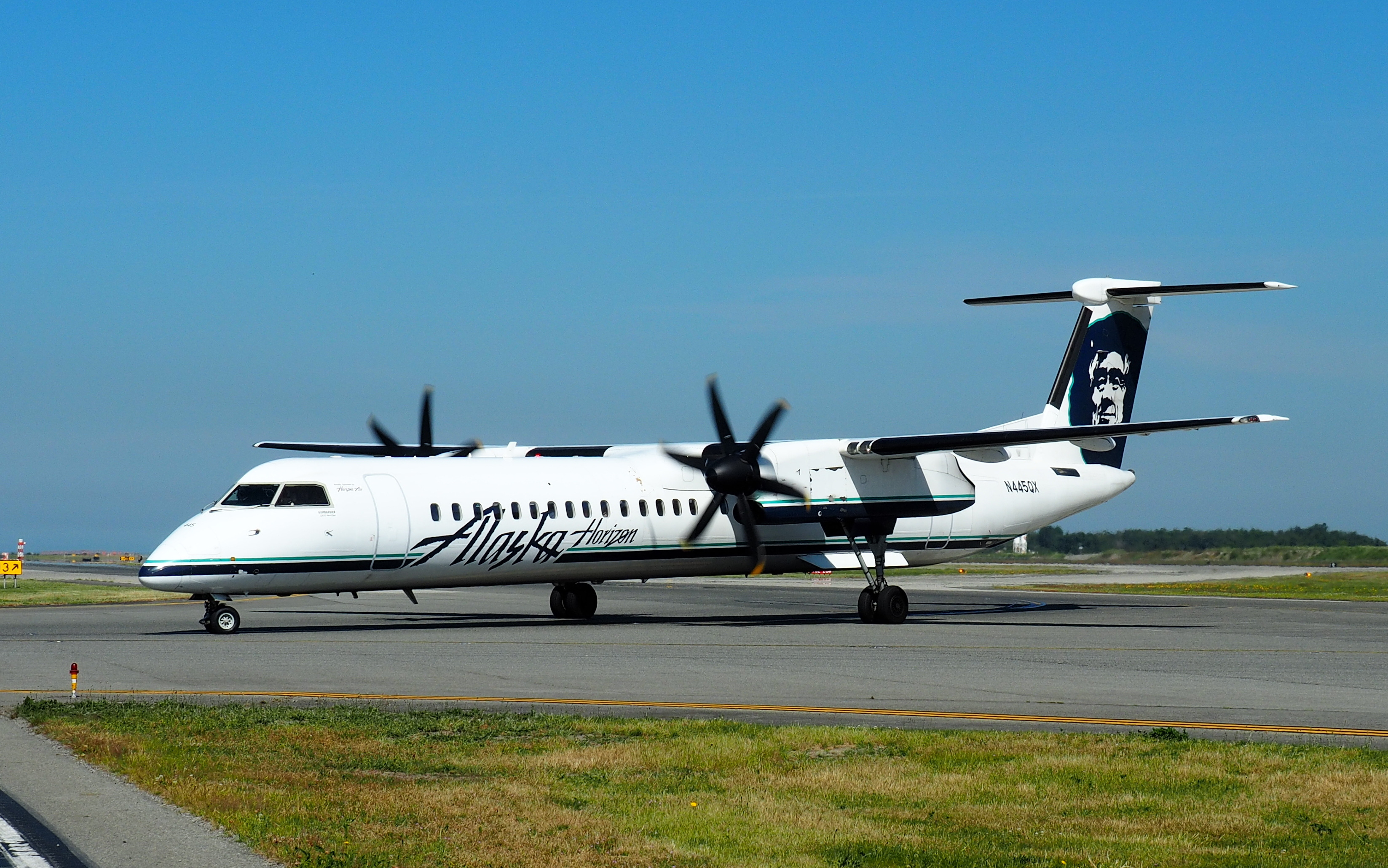 An Alaska Airlines Q400 - now De Havilland Canada DHC-8-400 - taxies in at YVR.