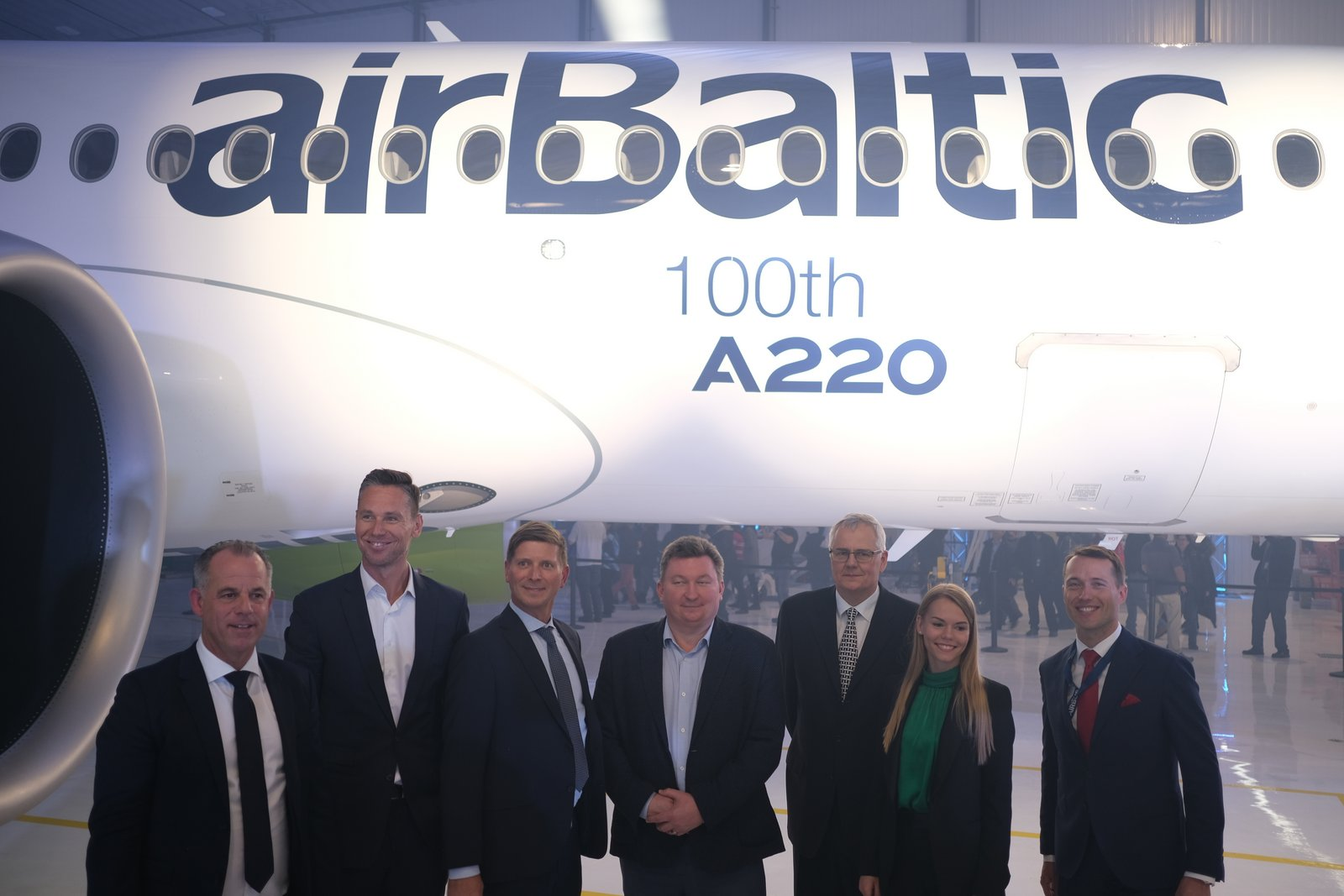 airBaltic executives celebrate the delivery of their 21st A220-300.